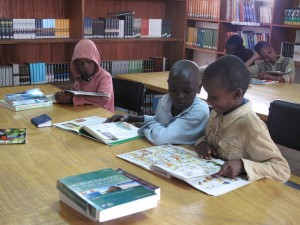 Children reading comic in Kenyan village library